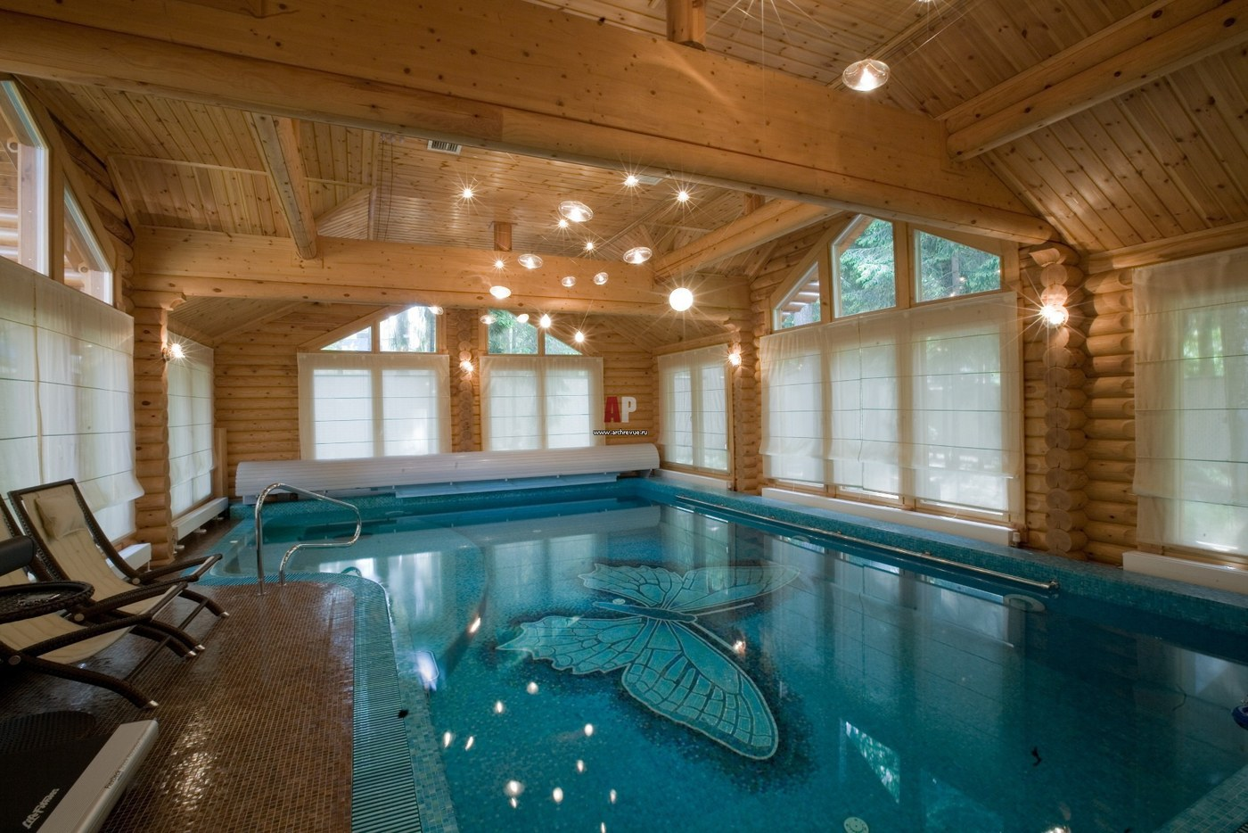Wooden houses with swimming pools
