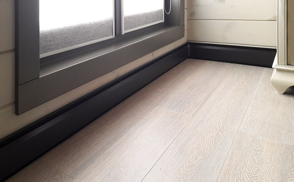 Floor heating system for a wooden house