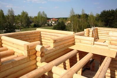 Turnkey house of log of natural humidity with a half-storey, Polish project